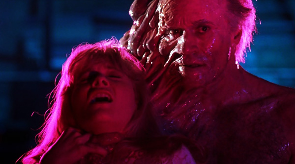 from-beyond-movie-1986-review-pretorius-holds-katherine-mcmichaels-hostage-barbara-crampton-ted-sorel